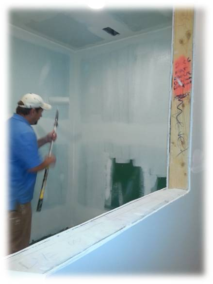 Philips contractor painting the wall