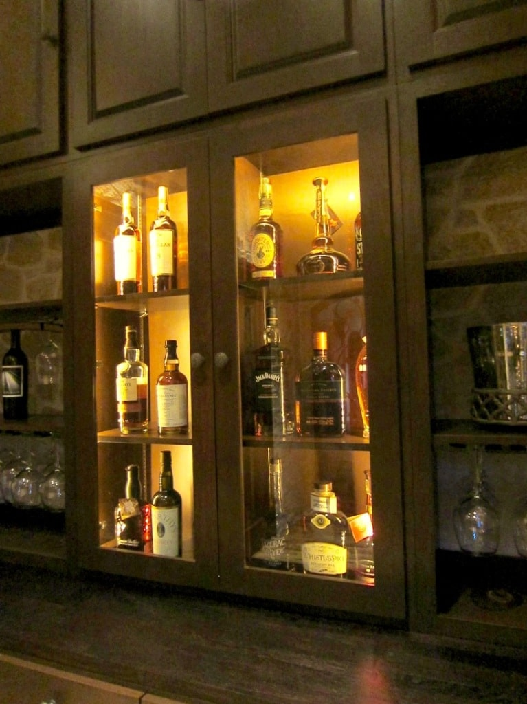 center lighted cabinet with glass Texas wine tasting room