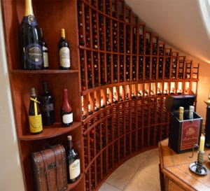 Custom Wine Racks built underneath unique staircase