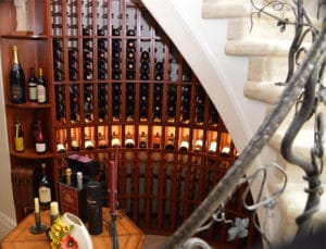 A view of Custom Wine Racks from the Vineyard inspired staircase