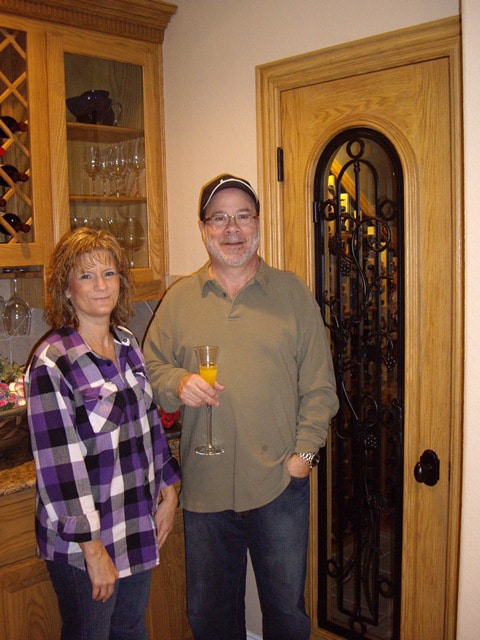 The Danns in Front of their New San Antonio Home Wine Cellar