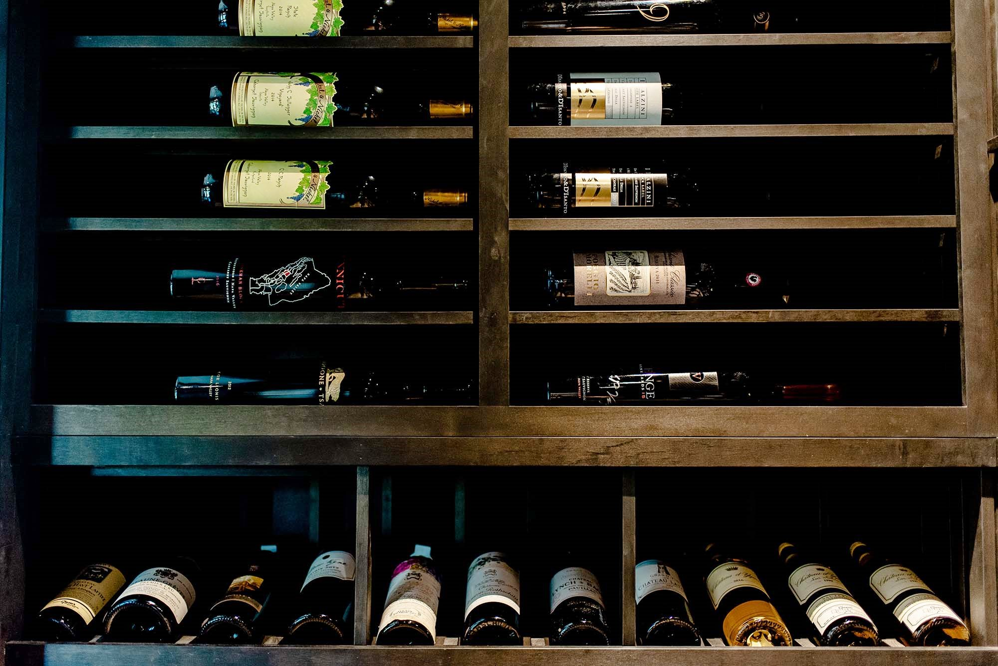 The Texas experts incorporated horizontal wine racks into the modern wine cellar design.